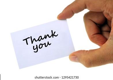 Thank you written on a white card