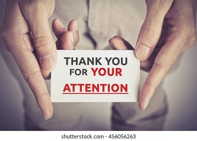 Thank you for your attention - card hold by man