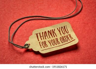 merci pour votre commande - signer un prix papier contre le concept de papier rouge texturé, d'achat et d'appréciation