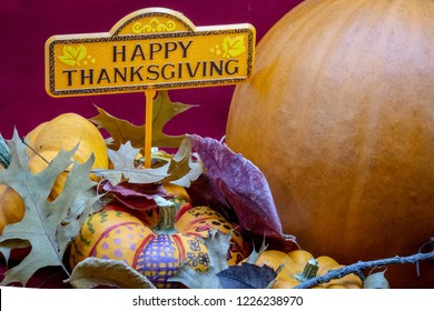 A thankful message of Happy Thanksgiving with fall decorations