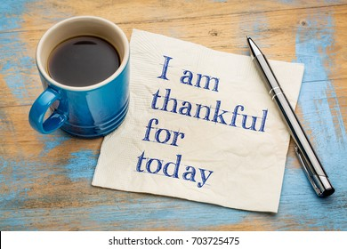 I am thankful for today - handwriting on a napkin with a cup of espresso coffee