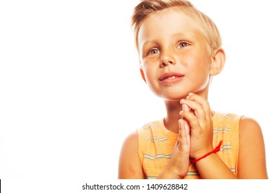 Thankful viewer concept. Portrait of smiling cute little boy in orange sleeveless T-shirt isolated on white background. Retro postcard, vintage poster style. Close up. Copy-space. Studio shot