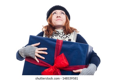 Thankful winter woman holding big present and looking up, isolated on white background.