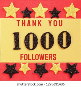 Thanks 1000, 1K, followers. message with black shiny numbers on red and gold background with black and golden shiny stars for social network friends, followers,