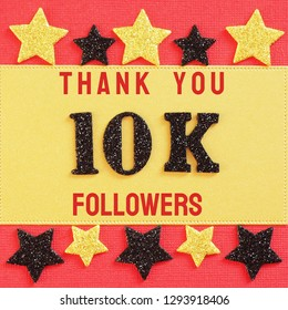 Thanks 10K, 10000, followers. message with black shiny numbers on red and gold background with black and golden shiny stars for social network friends, followers,likes
