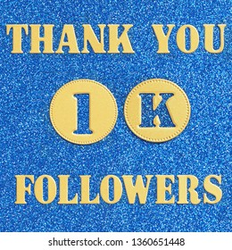 Thanks 1K, 1000  followers. message in gold letters and numbers on a brilliant blue background for social network friends, followers,