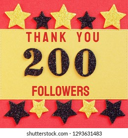 Thanks 200 followers. message with black shiny numbers on red and gold background with black and golden shiny stars for social network friends, followers,