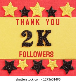 Thanks 2000, 2K followers. message with black shiny numbers on red and gold background with black and golden shiny stars for social network friends, followers,likes