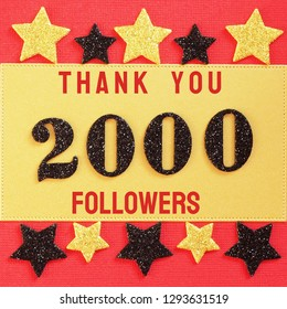 Thanks 2000, 2K, followers. message with black shiny numbers on red and gold background with black and golden shiny stars for social network friends, followers,likes