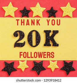 Thanks 20K, 20000 followers. message with black shiny numbers on red and gold background with black and golden shiny stars for social network friends, followers,likes
