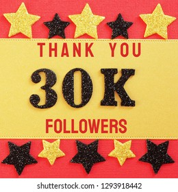 Thanks 30K, 30000 followers. message with black shiny numbers on red and gold background with black and golden shiny stars for social network friends, followers,likes