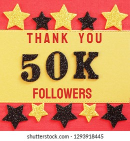 Thanks 50K, 50000 followers. message with black shiny numbers on red and gold background with black and golden shiny stars for social network friends, followers,