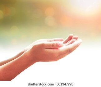Thanks God concept: Christian open healing hand with palms up on spiritual light background