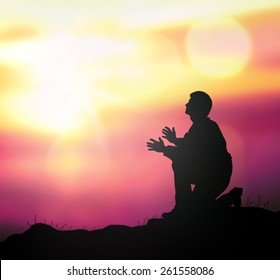 Thanks God concept: Prayer kneeling and praying over supernatural light background.