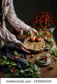 Thanksgiving apple  pie, top view, copy space on the rustic background. Fall traditional homemade apple  pie for autumn holiday. Woman holds an apple pie