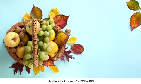 Thanksgiving art; autumn leaves and Fruit basket with fresh autumn Fruit