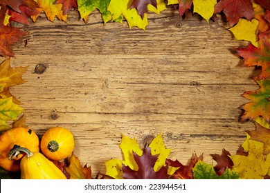 Thanksgiving Autumn Fall background with red, brown and yellow leaves and pumpkin