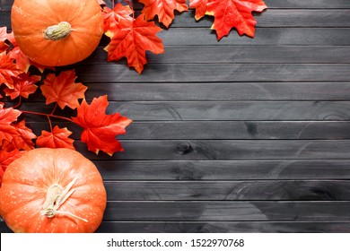 Thanksgiving background. Autumn background with pumpkin, candied oranges and copy space. Top view.