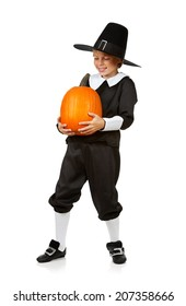 Thanksgiving: Boy Pilgrim Carrying Heavy Pumpkin