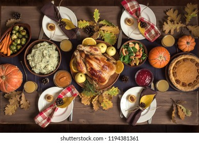Thanksgiving Celebration Traditional Dinner Setting Food Concept. Thanksgiving Turkey with all sides on table, lots of seasonal festive food.