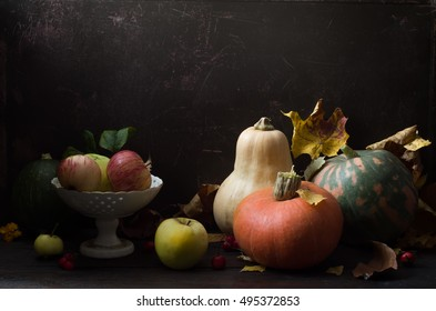 Thanksgiving day autumnal still life with pumpkins on old wooden table