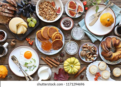 Thanksgiving Day Brunch. Autumn family breakfast or brunch set served on rustic wooden table. Overhead view, copy space
