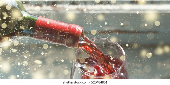 Thanksgiving Day. Christmas. Celebration. pouring red wine. Wine in a glass. selective focus, motion blur, Red wine in a glass. Sommelier wine into the glass on a blue background old.