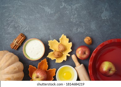 Thanksgiving day cooking and baking background with apples and pumpkin pie ingredients