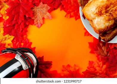 Thanksgiving day football game, happy autumn holiday and festive gameday concept with top view of roasted turkey and american football helmet surrounded by leaves with orange background and copy space