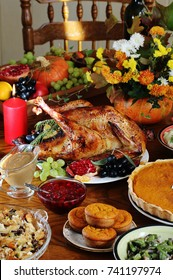 Thanksgiving Day. the traditional dishes for Thanksgiving. young turkey, cranberry sauce, pumpkin pie, stuffing, gravy, mashed potatoes, green beans, pumpkin muffins.