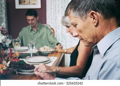 Thanksgiving: Family Says Prayer Before Dinner