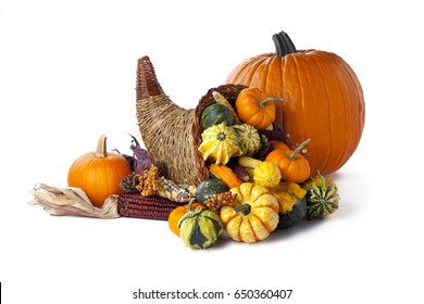 Thanksgiving festive cornucopia horn of plenty filled with autumn fruits and vegetables; isolated on white background