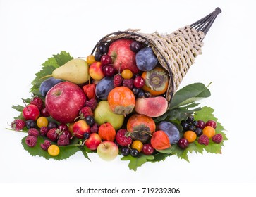 Thanksgiving festive cornucopia horn of plenty filled with autumn fruits