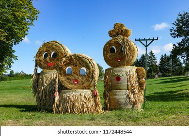 Thanksgiving figures of straw bales