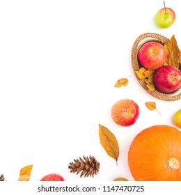 Thanksgiving frame made of fall dried leaves, pine cones, apples and pumpkin on white background. Flat lay, top view. Autumn composition