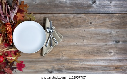 Thanksgiving holiday dinner setting on rustic wood