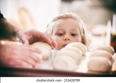Thanksgiving: Little Girl Hungry For Baked Rolls