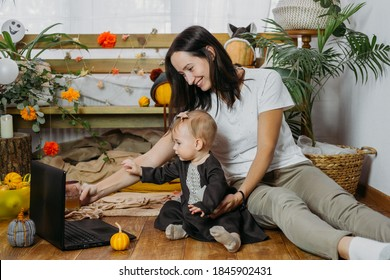 Thanksgiving online party, virtual dinner gathering. Holidays in the Time of COVID new normal, Pandemic time. Happy family, friends, mother and baby celebrating Thanksgiving via internet near laptop