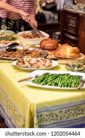 Thanksgiving table with food on it.  Preparing for family pot luck.
