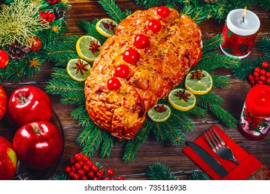 Thanksgiving table served with  baked meats, decorated with bright Christmas decor and candles. Christmas dinner with roasted pork meat. The concept of a family holiday, delicious food