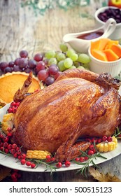 Thanksgiving Turkey dinner on old wooden table with copy space