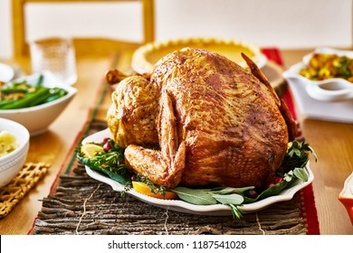 Thanksgiving turkey on dinner table with side dishes