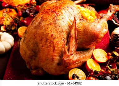 Thanksgiving Turkey on with fall decorations and mashed sweet potatoes, Swiss chard, and cranberry sauce