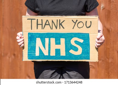 Thank-you NHS Message  written on Cardboard sign.