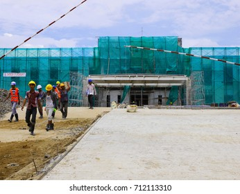 THANLYN/MYANMAR - August 20, 2015: Workers at Thilawa Special Economic Zone during construction