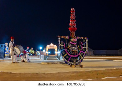Thar desert, Rajasthan, India - October 15th 2019 : Female dancer dancing Bhavai, a folk dance, balancing six earthen pots on her head, dressed with cultural dress of Rajasthan.