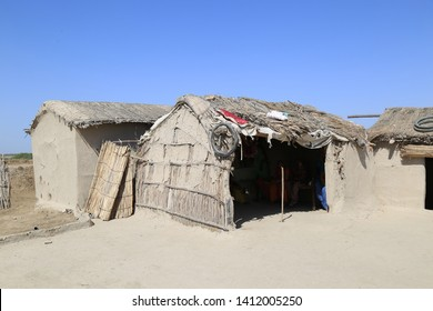 Tharparkar Sindh, Pakistan - March, 2019: Exterior View of Poor hut house in a village in Thar Pakistan, Poverty in Pakistan, It is the desert area and the most affected by drought in Pakistan
