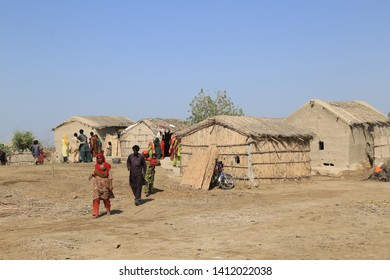 Tharparkar Sindh, Pakistan - March, 2019: Exterior View of Poor hut house, People coming out from house Thar, Poverty in Pakistan, It is the desert area and the most affected by drought in Pakistan