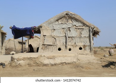 Tharparkar Sindh, Pakistan - March, 2019: Exterior View of Poor hut house in a village in Thar Pakistan, Poverty in Pakistan, Barren Land, the desert area and the most affected by drought in Pakistan
