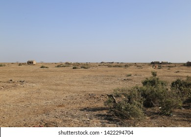 Tharparkar Sindh, Pakistan - March, 2019: View of Barren Land desert of Thar Pakistan, Poor Huts in Village Poverty in Pakistan, the desert area and the most affected by drought in Pakistan